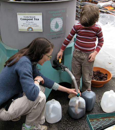 With mom's guidance, a young gardener learns the benefits of compost tea right from the spigot.